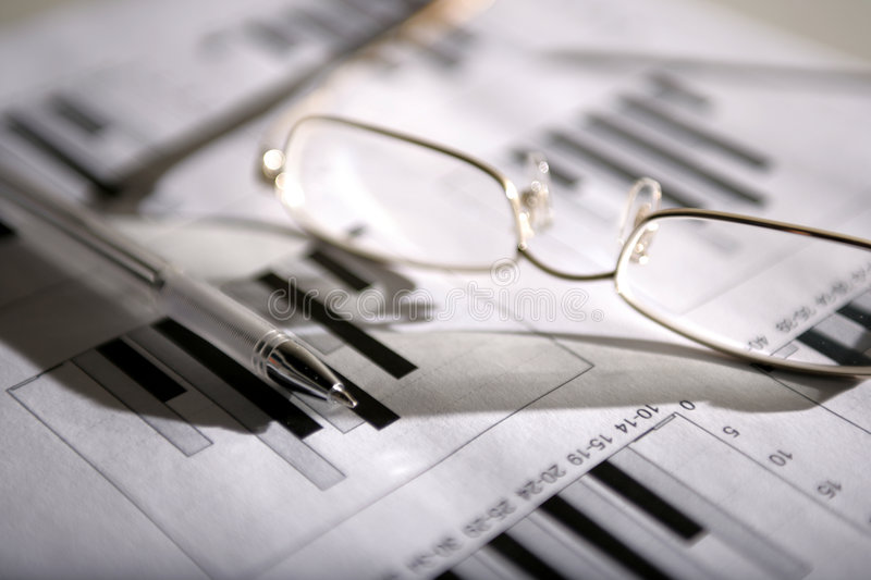 Glasses and pen stock photo