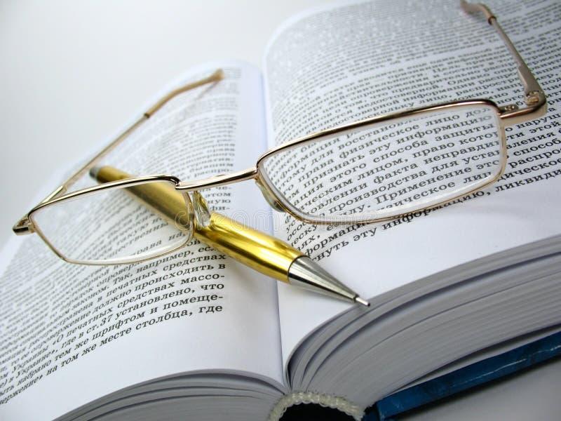 Glasses & pen on book 2 stock photo