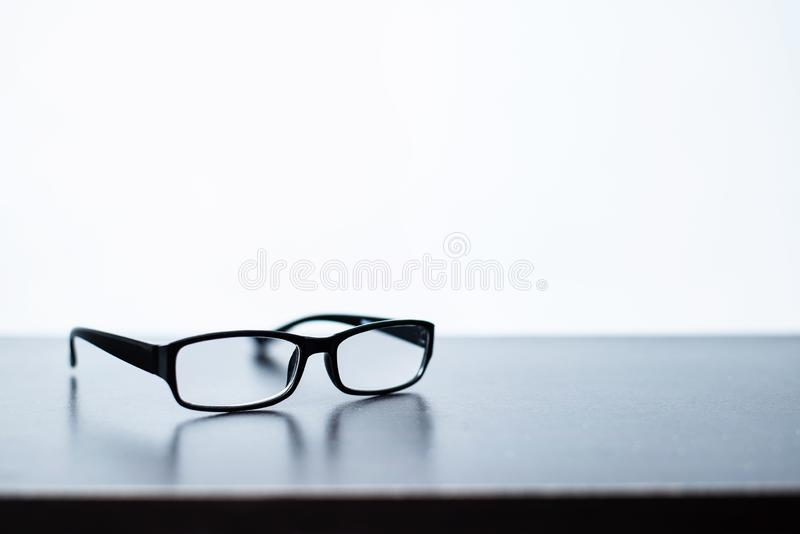 Glasses placed on the desk with white background stock image