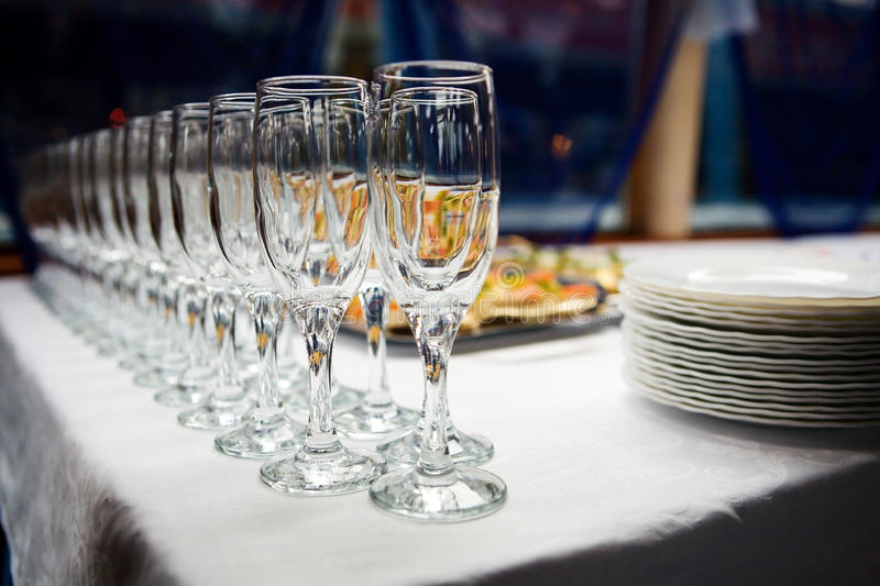 Glasses and plates stock images
