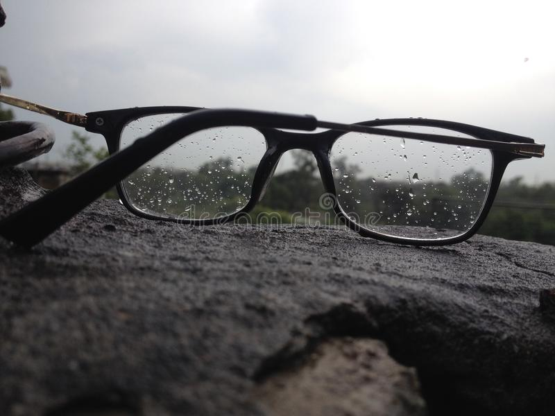 Glasses with rain drops. This picture focuses the rain drops on the glasses royalty free stock photos