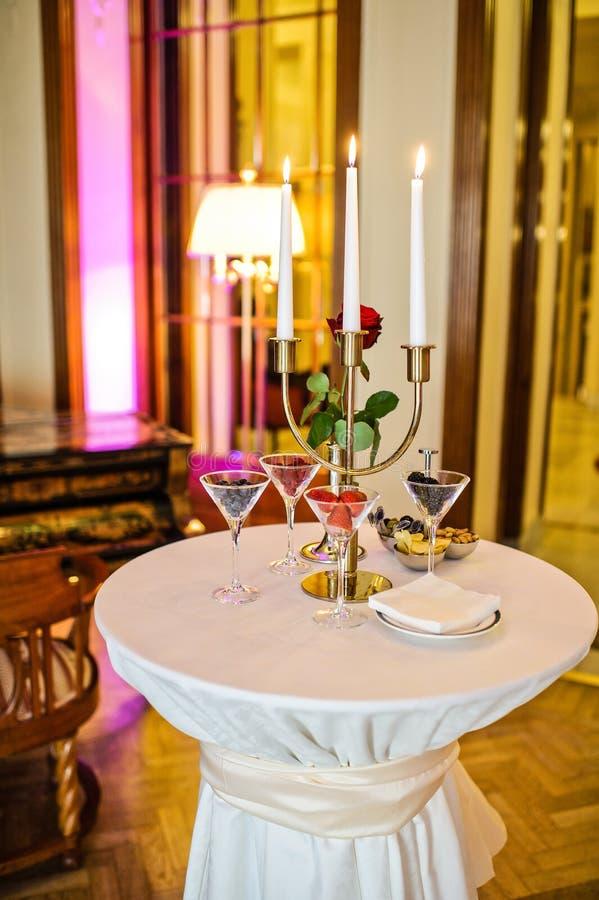 Glasses of raspberries, strawberries, blackberries. Gala dinner in a luxurious restaurant royalty free stock images