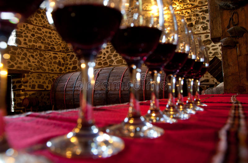 Glasses red wine degustation. Glasses of red wine for degustation in a row on table royalty free stock image