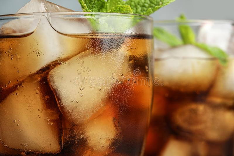 Glasses of refreshing soda drinks with ice cubes. Closeup royalty free stock photos