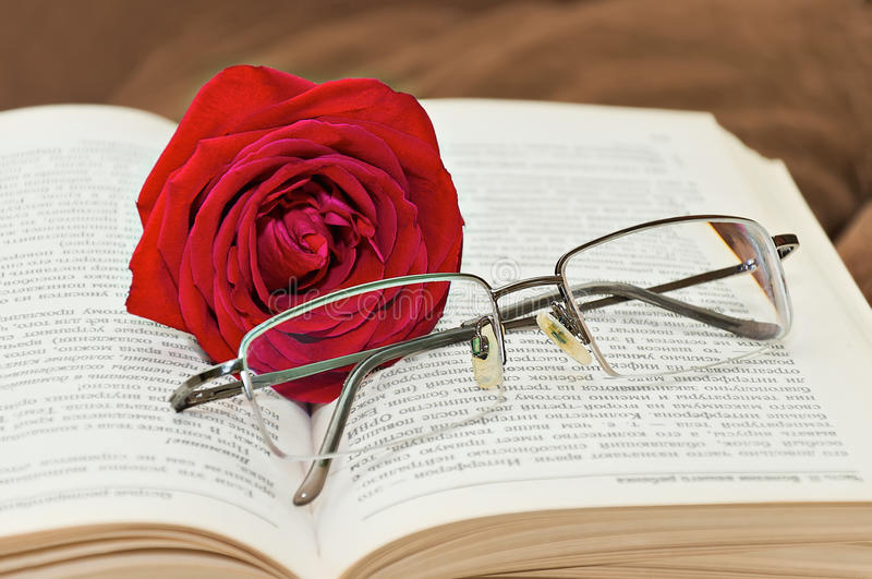 Download Glasses And Rose Over The Book Stock Photo - Image: 24270702