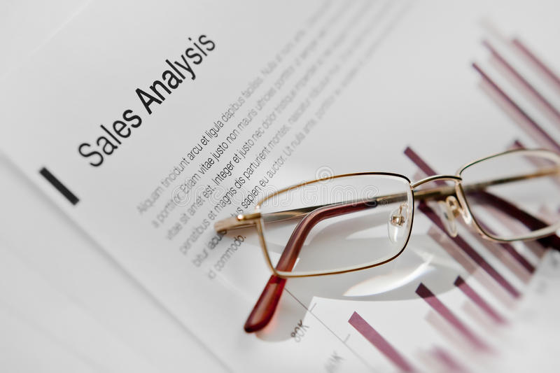 Download Glasses On Sales Analysis Document Stock Photo - Image: 26486776