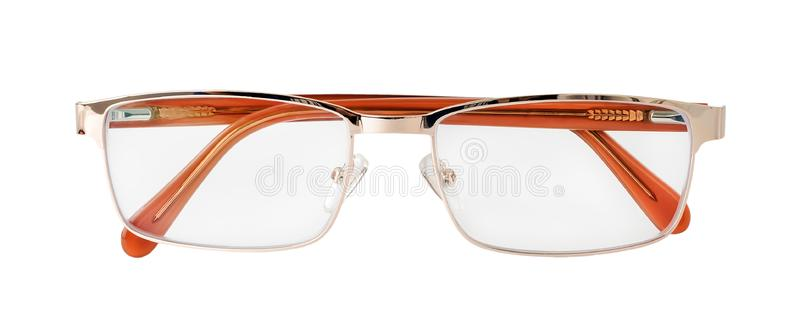 Glasses for sight with the golden rim isolated on white background. Golden eye glasses for reading and computer work. Myopia,. Hyperopia and vision correction stock image