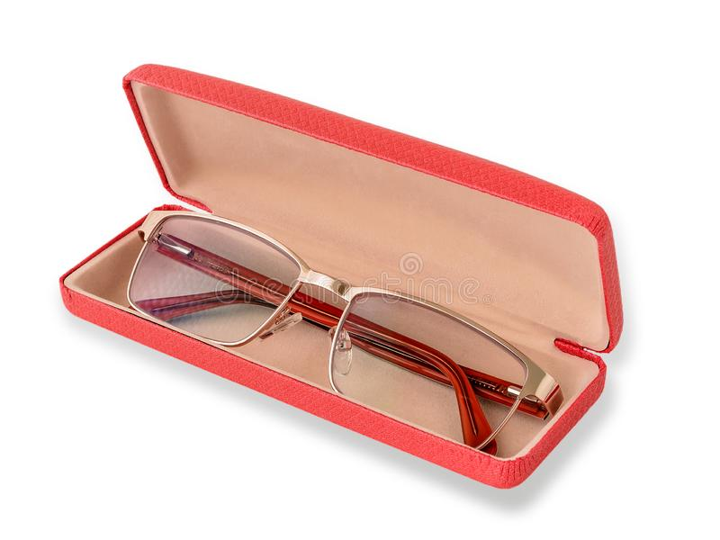 Glasses for sight with a golden rim in a pink glasses case. Golden eye glasses for computer work and reding. Myopia, hyperopia and. Vision correction. Isolated royalty free stock photo
