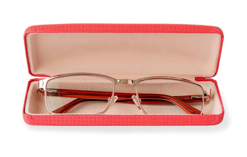 Glasses for sight with a golden rim in a pink glasses case. Golden eye glasses for reading and computer work. Myopia, hyperopia. And vision correction. Isolated stock photos