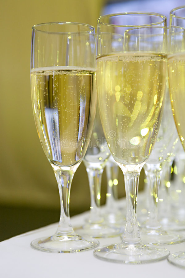 Glasses with sparkling white wine royalty free stock image