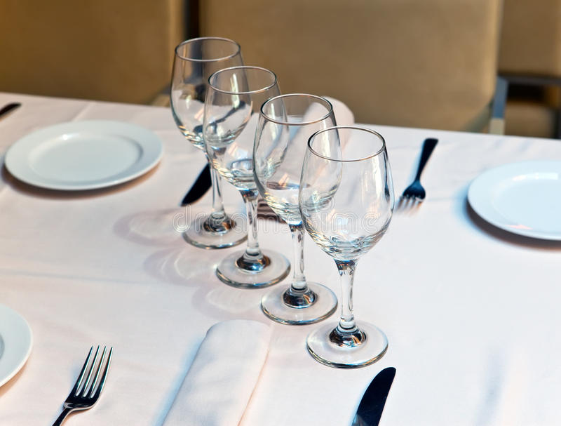 Glasses on table at restaurant stock photography