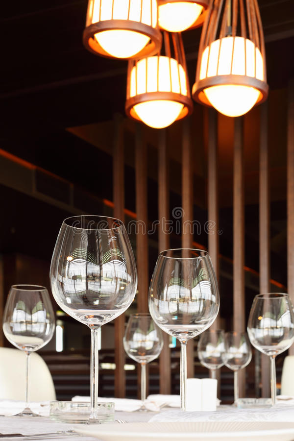 Glasses At Table With Tablecloth In Restaurant Royalty Free Stock Photo