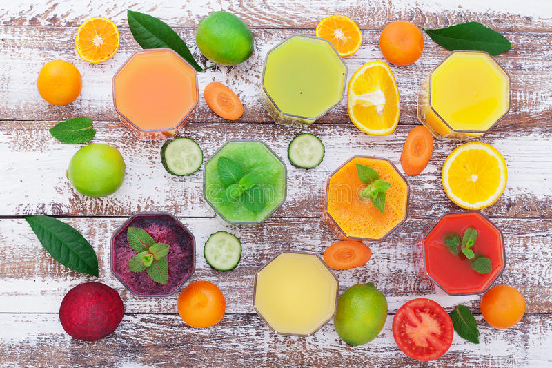 Glasses of tasty fresh juice, on wooden desk. royalty free stock photos