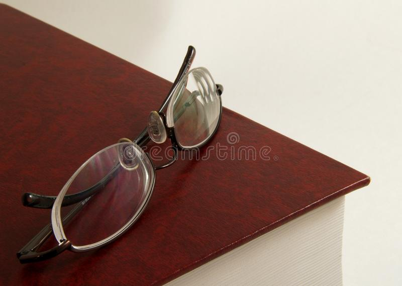 Glasses on top of Book royalty free stock photography