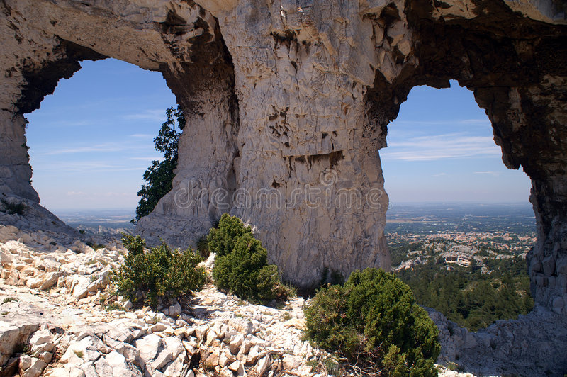 Glasses of Van Gogh. Two holes in a rock in the Alpilles mountains in Provence, South of France. Called the glasses of van Gogh because of the view to Saint Remy stock photo