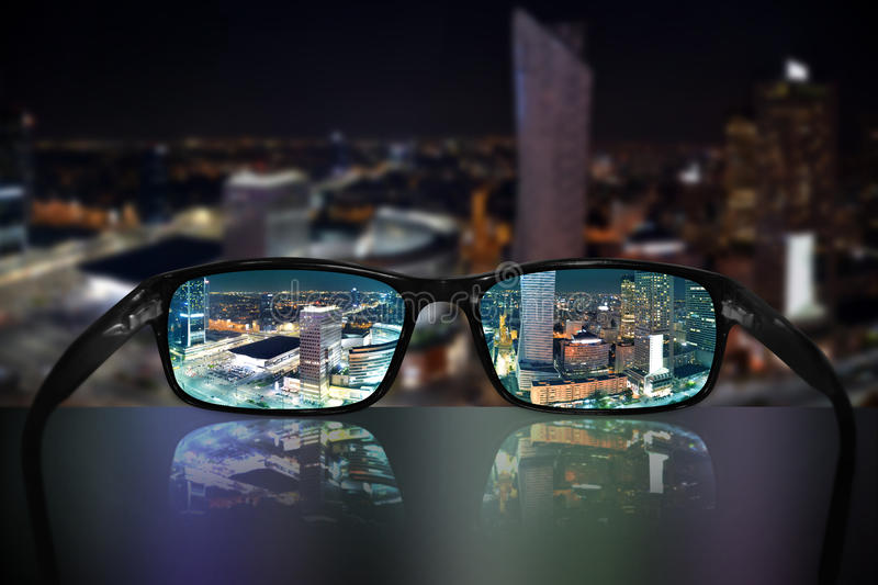 Glasses, vision concept, Warsaw, Poland. Glasses and Warsaw Poland cityscape - great for topics like vision, sightseeing, business concept or eyesight problems stock photography