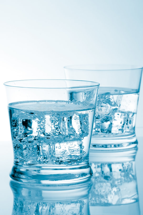 Glasses of water with ice with copyspace royalty free stock image