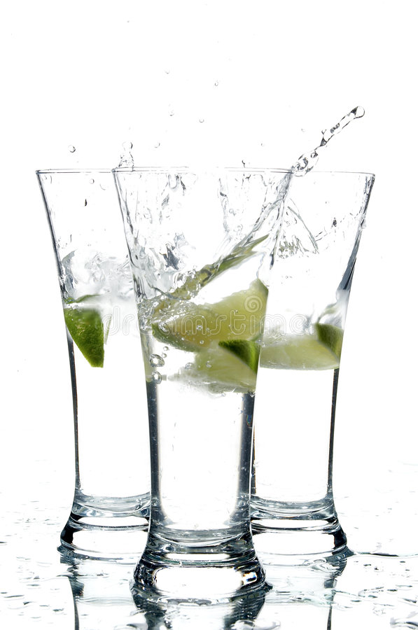 Glasses with water and lime; royalty free stock photography