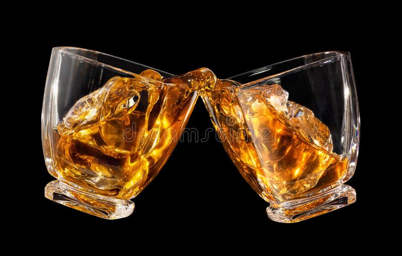 Glasses of whiskey making toast royalty free stock photography