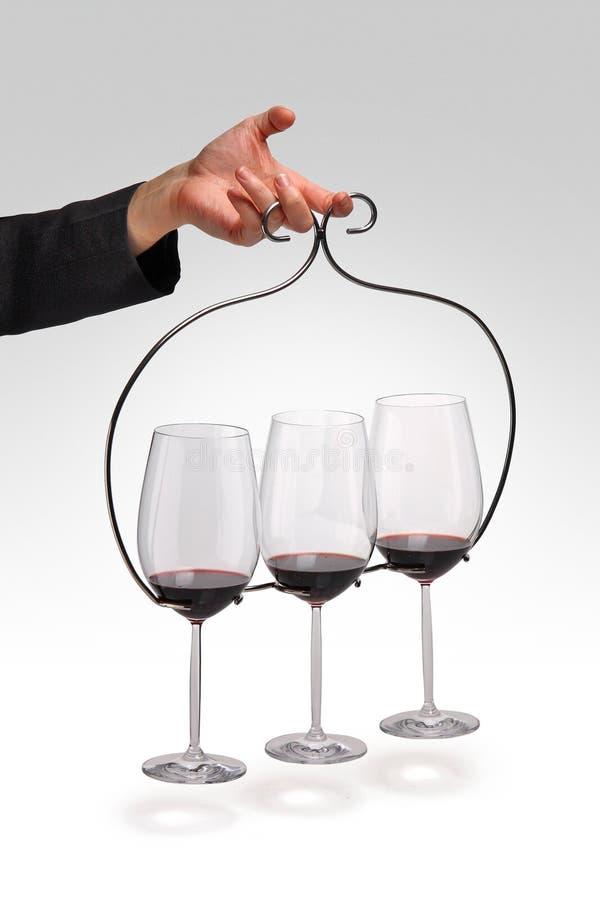 Glasses of wine. Wine glasses on metal holder stock photos