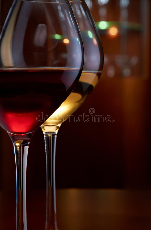 Glasses of wine in a bar. Two glasses of wine on the table in bar stock image