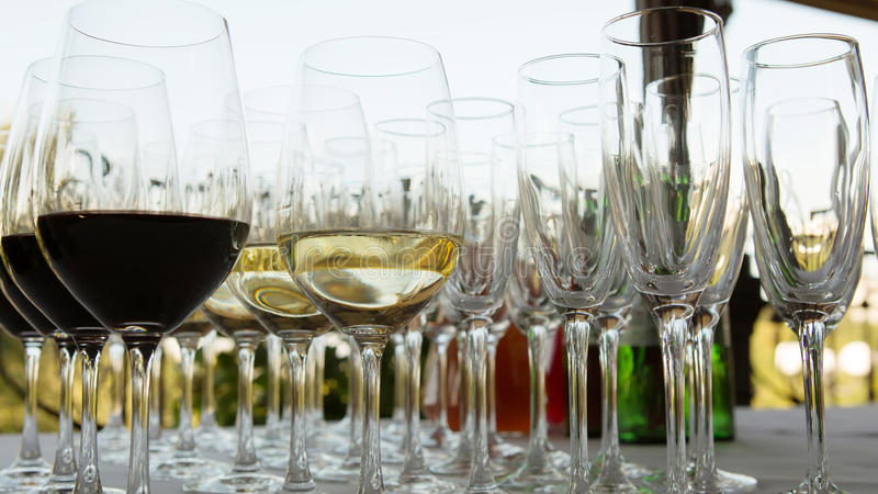Glasses of wine at the bar. Glasses of red and white wine at the bar stock photography