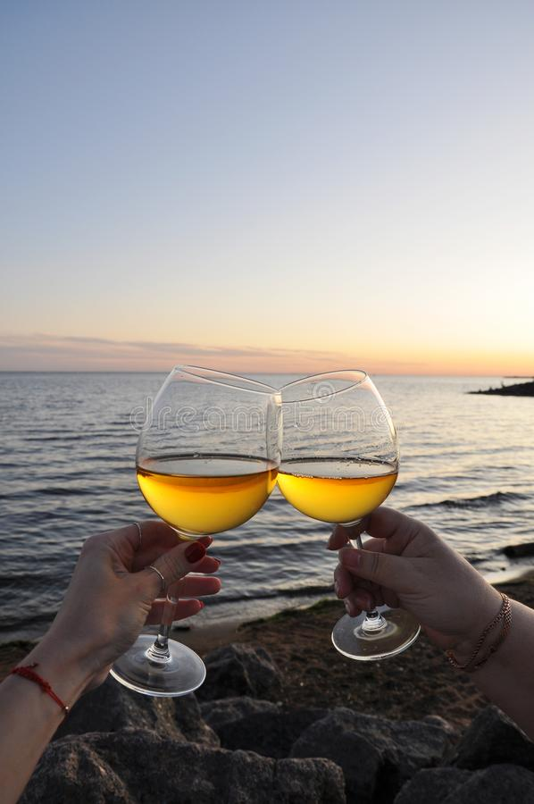 Glasses of wine on the beach stock image