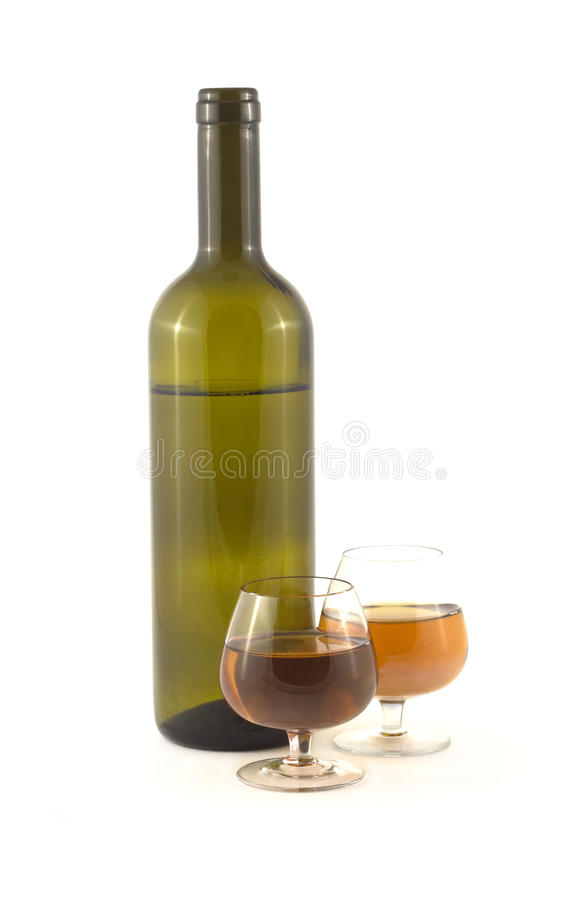 Glasses with wine and bottle isolated on white royalty free stock photography