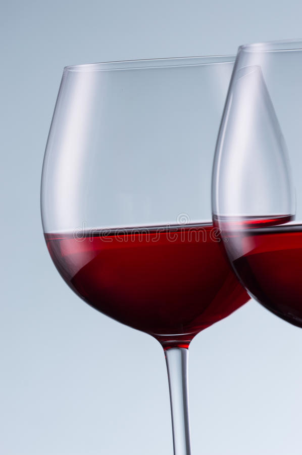 Glasses of wine on a light background royalty free stock images