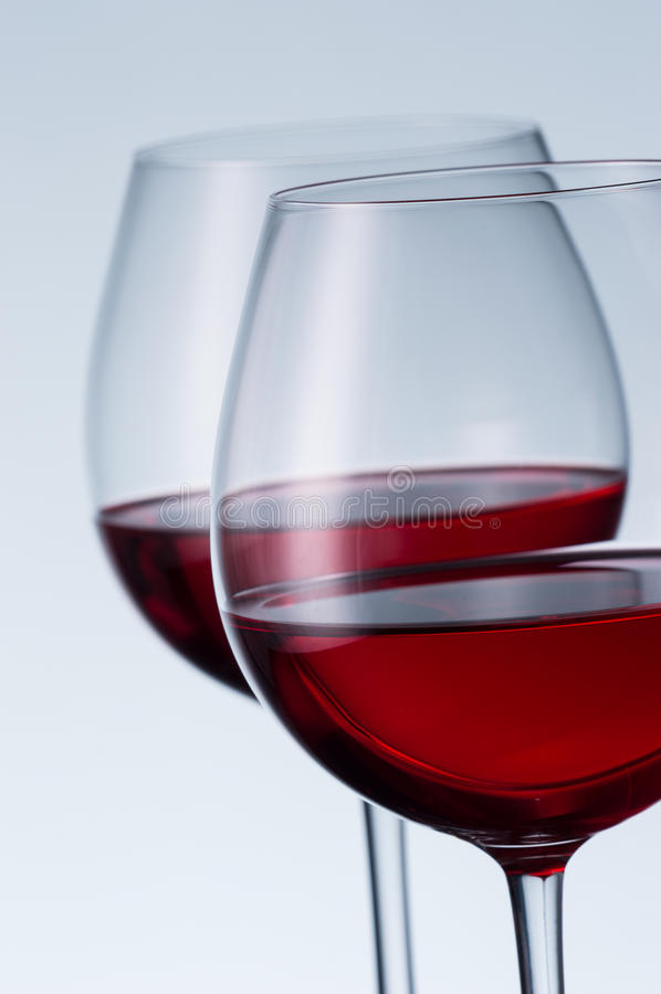 Glasses of wine on a light background stock photography