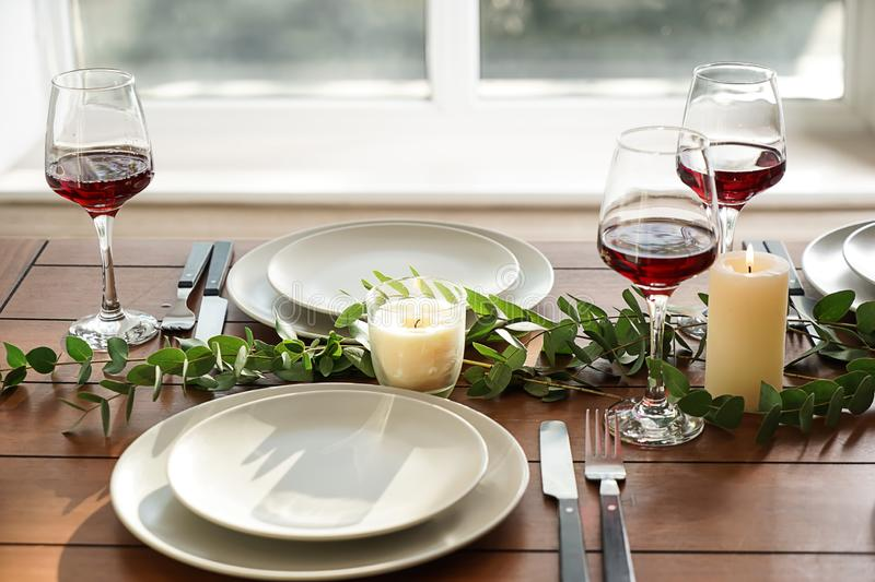 Glasses of wine on table set in restaurant royalty free stock image