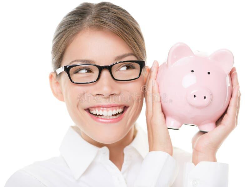 Glasses woman saving on eyewear showing piggy bank stock image