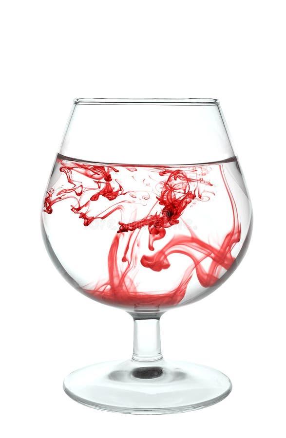 glassfull czerwona plam woda fotografia royalty free