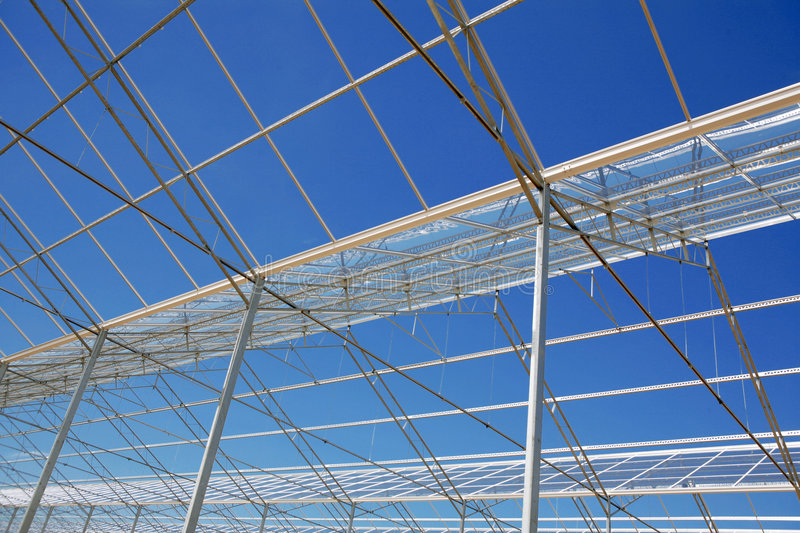 Glasshouse. And blue sky stock photography