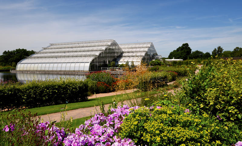 The grand glasshouse at Wisley. Designed by architect Peter van der Toorn Vrijthoff, the glasshouse has a plant display area equivalent to ten tennis courts and stock photos