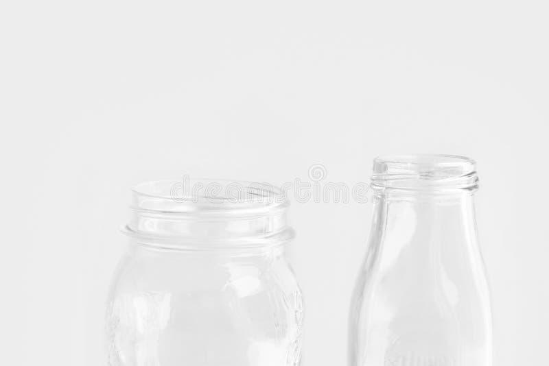 Glassware crystal bottle mason jar on white wall background. Reusable materials plastic-free alternatives zero waste. Environmental protection food storage royalty free stock images