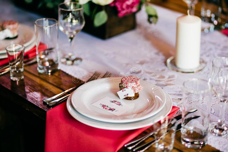 Glassware and cutlery for event dinner. Festive table with plates forks, knives, glasses, napkins and candle. Restaurant or cafe t. Able. Banquet and celebration royalty free stock photography