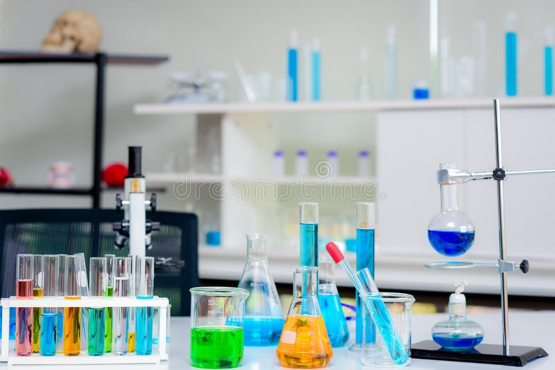 Glassware equipment in chemical laboratories stock images