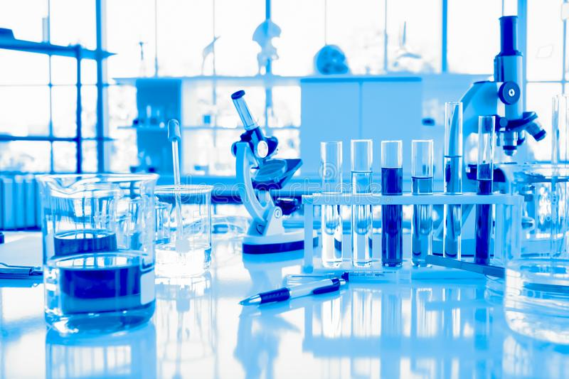 Glassware equipment in laboratory for science or chemical experiments, medical and pharmaceutical research concept. Blue tone royalty free stock images