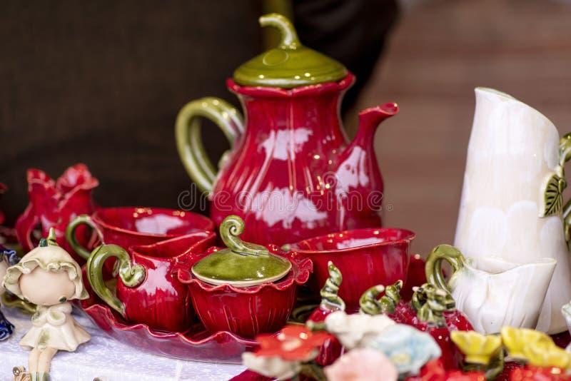 Ceramic Designer Cups. Designer handmade dishes, plates and cups in a stylish boutique. Hand Painted Ceramic . Unusual ceramic stock photos