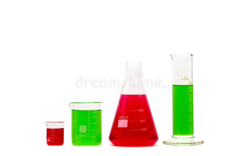 Glassware filled with green and red liquids. Isolated on white. stock photo