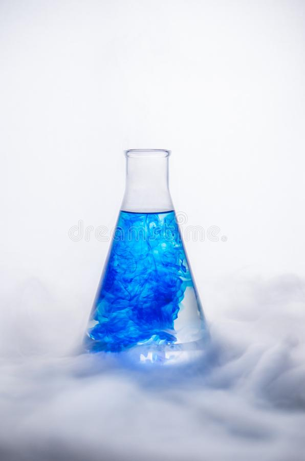 Glassware. Mixing liquids. Laboratory analysis. Chemical reaction. stock images