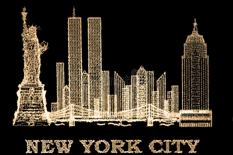 Glasswork. Closeup of laser 3D glass engraving of New York city in gold royalty free stock photo