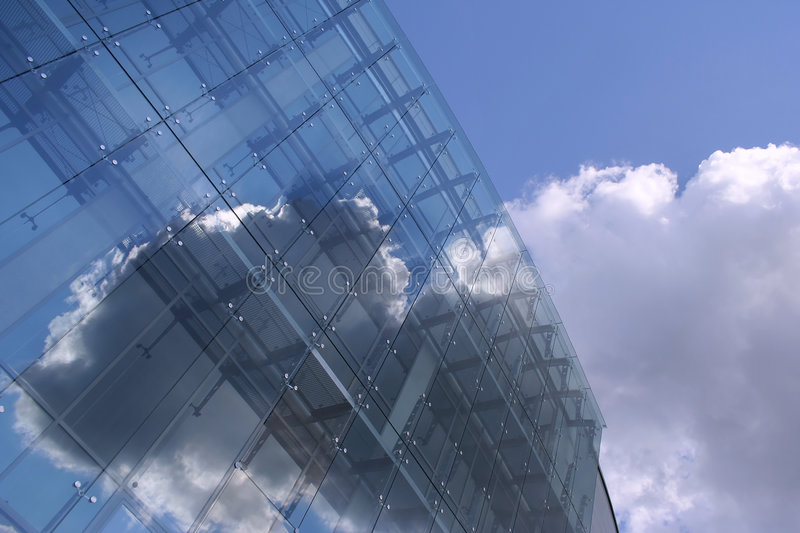A Glassy Future Edifice On The Blue Sky Royalty Free Stock Photography