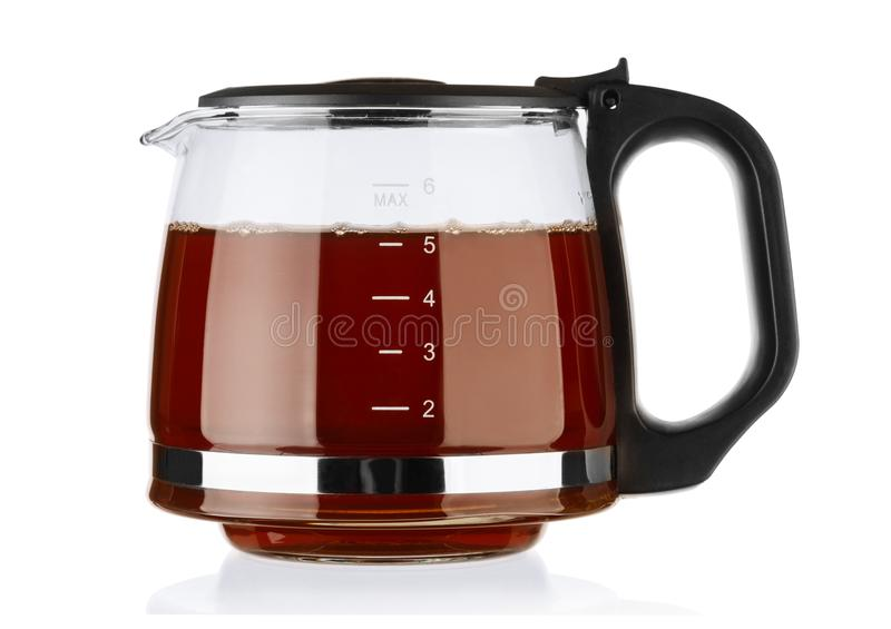 Glastheepot met thee op wit wordt geïsoleerd dat stock afbeeldingen