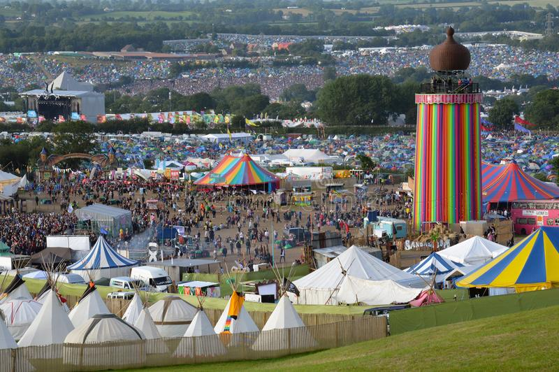Glastonbury Festival 06.27.2015. Looking out at the Ribbon Tower and teepee field at Glastonbury Festival. On a sunny evening with the Other Stage and Pyramid stock images