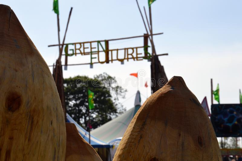 Glastonbury Festival. 06.26.2015. Looking up a the entrance to Green Futures field artistically blurred framed between two wooden royalty free stock photos