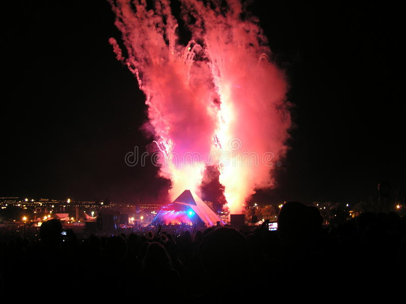 Glastonbury festival main stage pyrotechnics 2007. Revellers enjoy a fiery spectacle at the main pyramid stage, Glastonbury festival in Somerset England 2007 stock photos