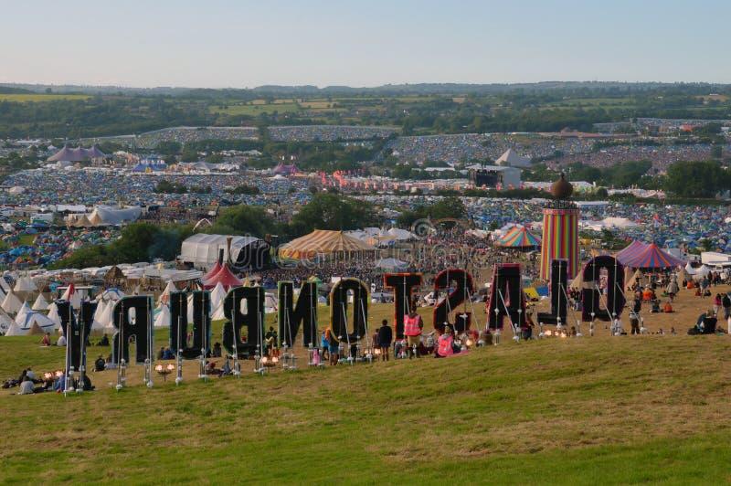 Glastonbury Festival, Somerset, UK. Behind the Glastonbury sign looking across the festival royalty free stock photo