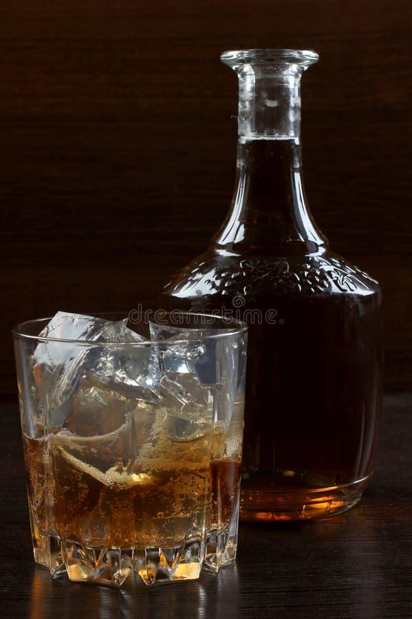 Glaswhisky op dark drie royalty-vrije stock foto